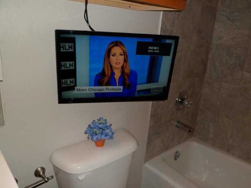 Watch TV while taking a bath or getting ready for your day