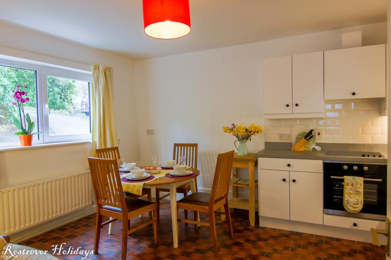 The kitchen dining area is spacious, and well lit. Seating for four, ideal if visiting friends