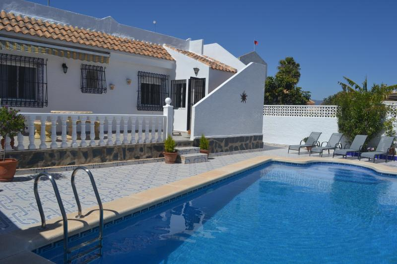 detached villa with sunbathing terraces and large private pool
