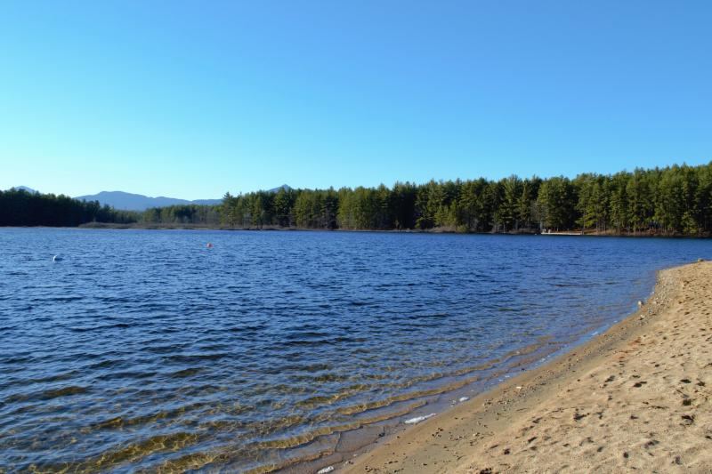 Sandy beach and mountain views on Moores Pond.