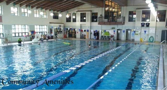 Large indoor heated pool in the community center. Lap swimming, diving board, and free swim