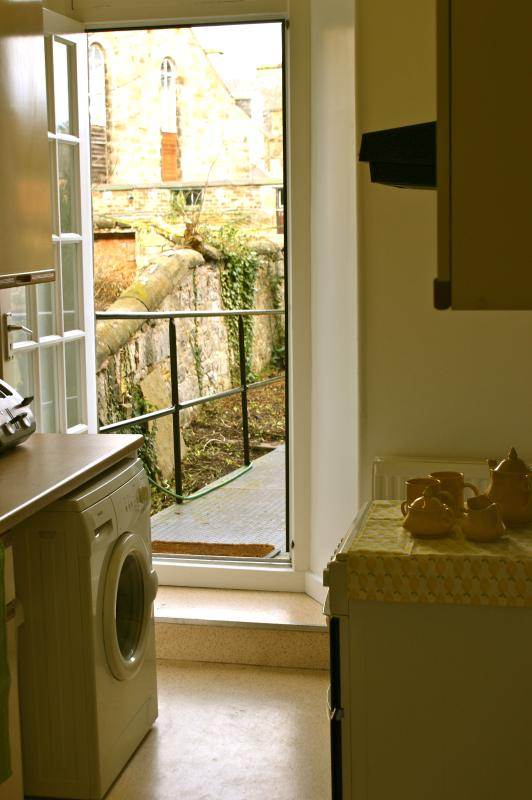 The fully equipped kitchen leads out to the pretty Victorian garden