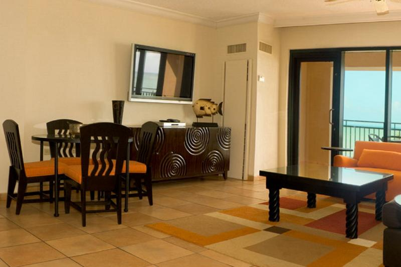 Living/dinning area with plasma screen TV