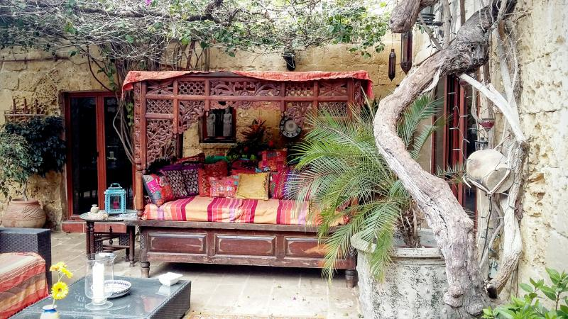 The exotic daybed in the courtyard where you can relax