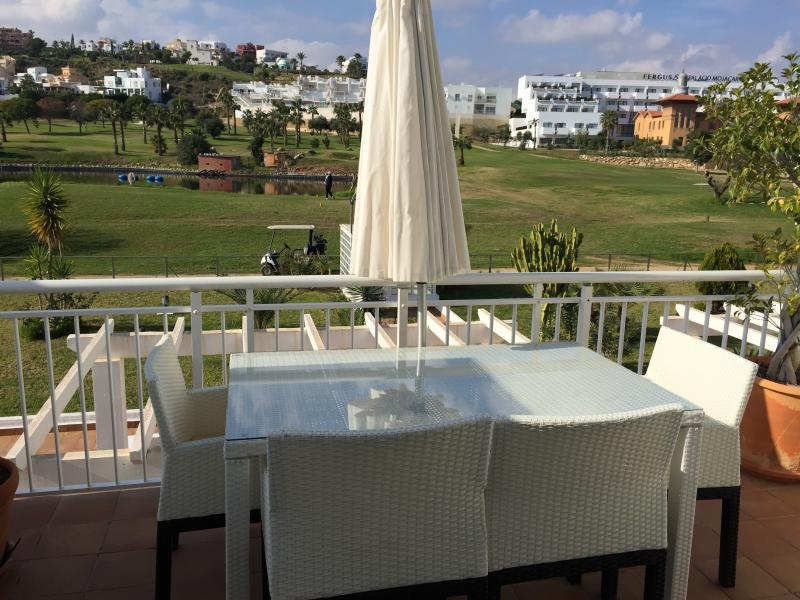 View of one of the balconies with the 18th Tee of golf course from the lounge.