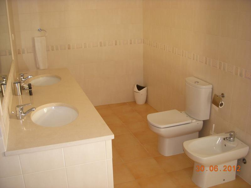 ensuite upstairs bathroom with shower.