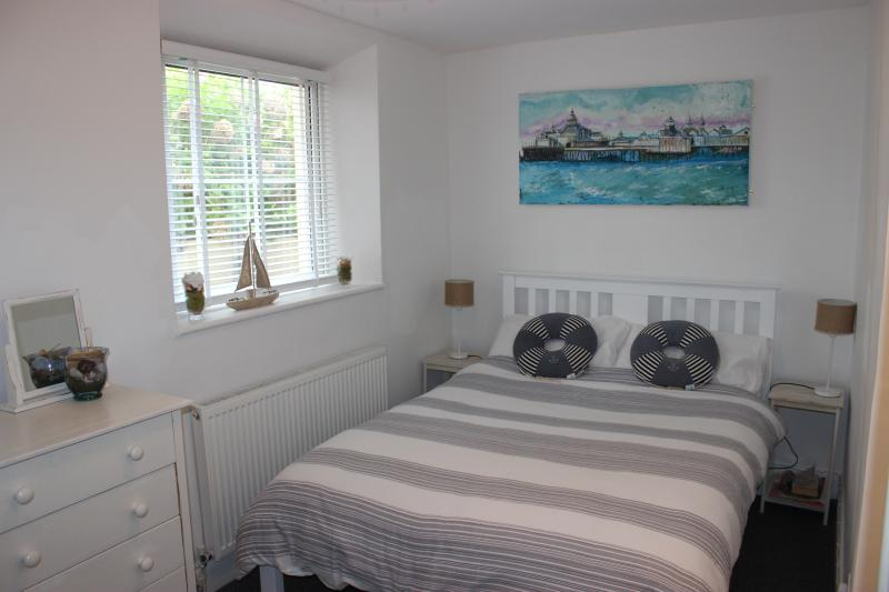 Comfortable Double Bedroom Space for a cot if required