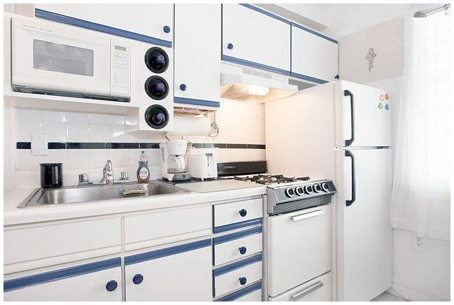 Kitchen furnished with microwave, toaster, coffee maker,   stove/oven and  2-Door Refrigerator