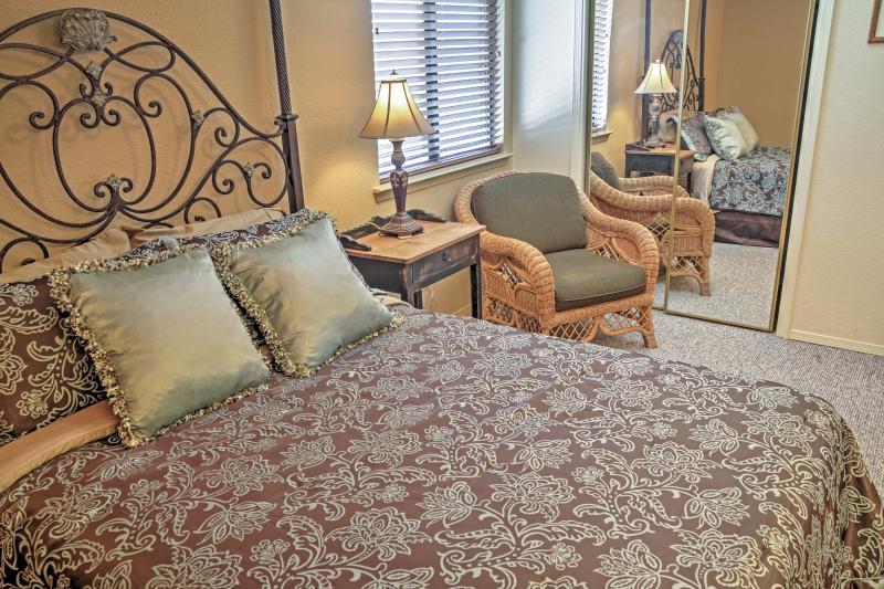Unwind in the alluring master bedroom.