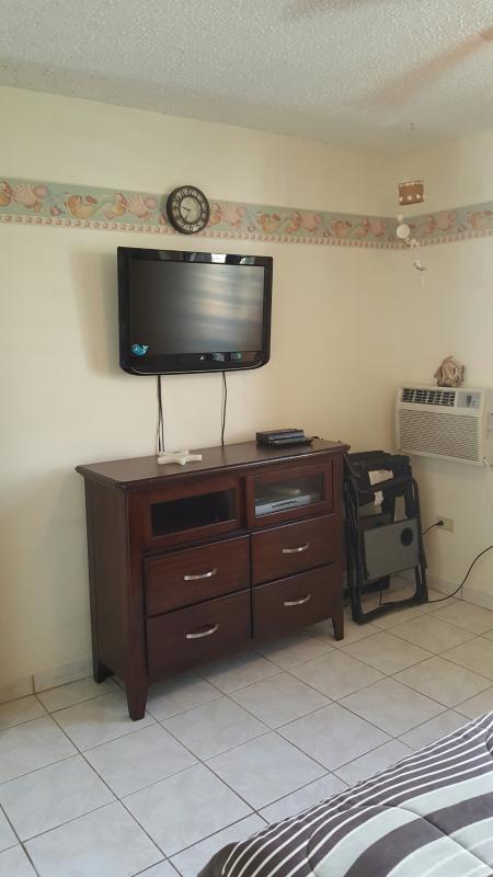 Cable TV/DVD set in master bedroom.
