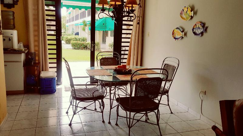 Dining area sits 4.  There is also another table/4 chairs in the outdoors terrace.
