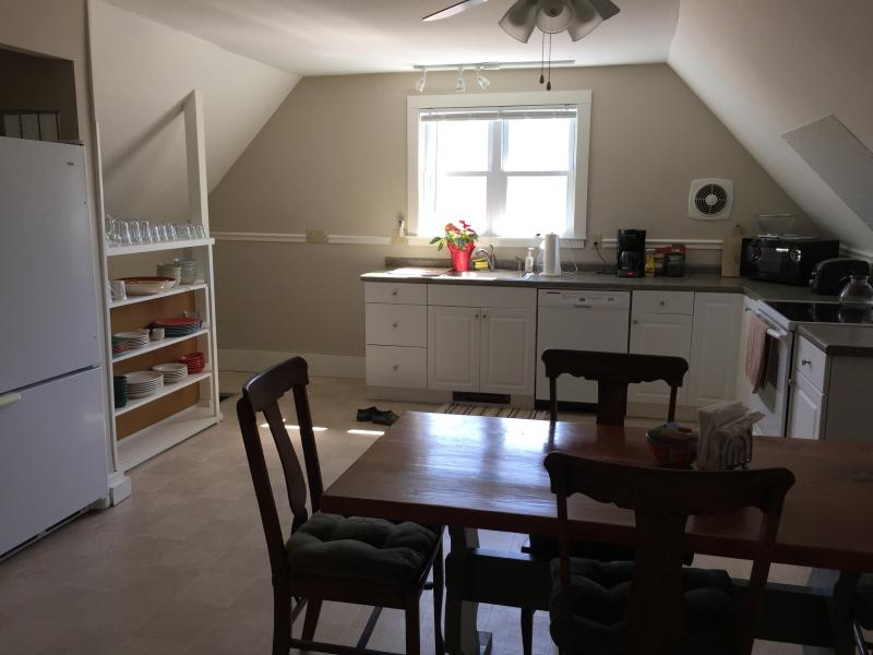 Large eat-in kitchen features full-size appliances and many small appliances