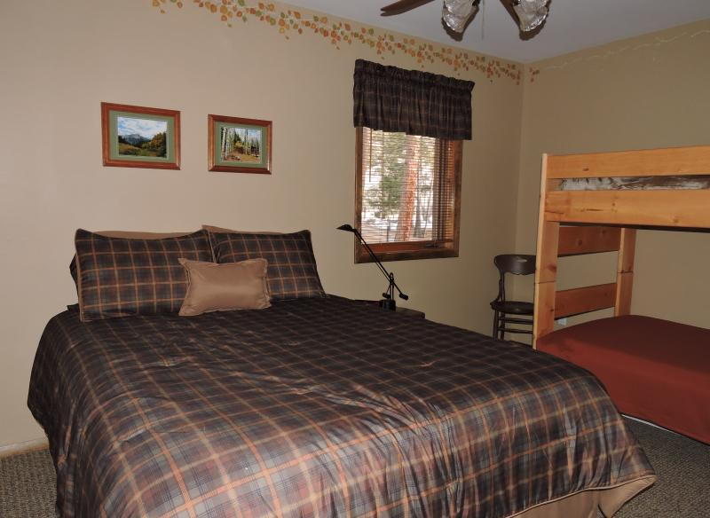 Aspen Room with queen bed and twin bunk beds.  Large closet.