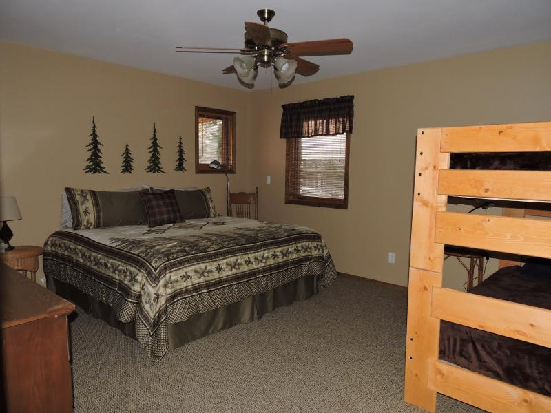 Master (Pine) Beddroom.  King bed, and twin bunk beds.  Large walk-in closet.