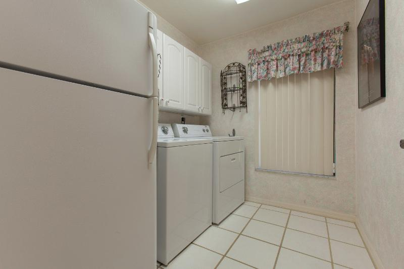 Laundry room is between two bedrooms.  has an extra refrigerator.