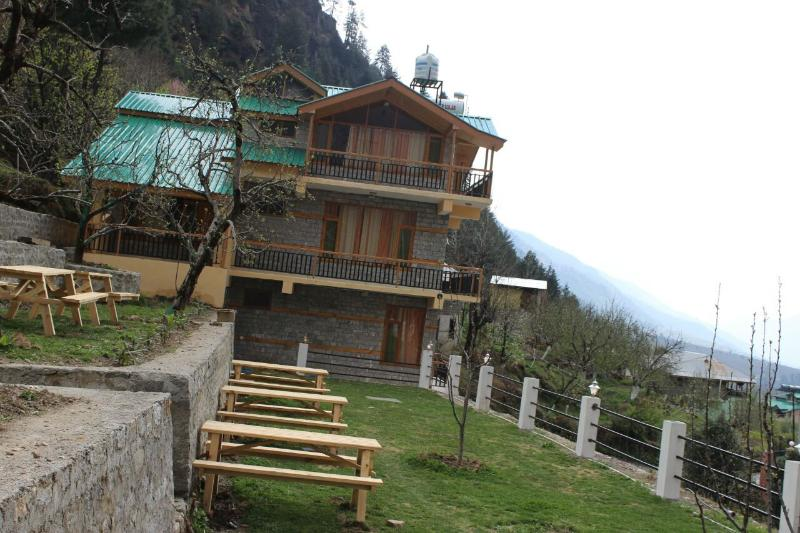 A calm &  beautiful property surrounded by Mountains and greenery  360 degrees..