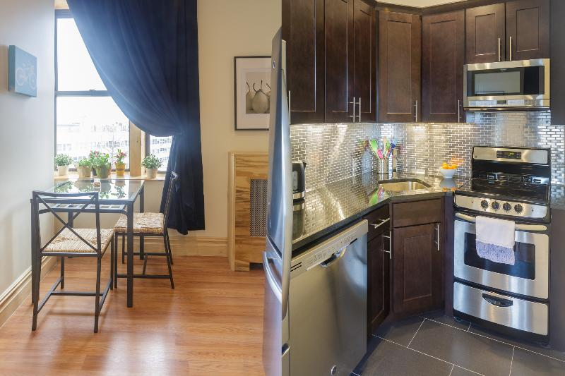 Left: Cafe table/chairs in kitchen Right: new kitchen with stainless appliances & granite counter