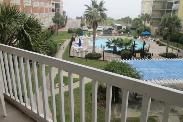 View from Balcony- Heated Pool and the Gulf
