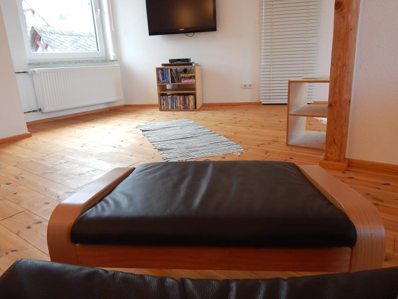 Loft style sitting room with satelitte TV channels in German and English