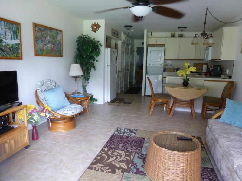 View of living room and kitchen. Kitchen is being remodeled.