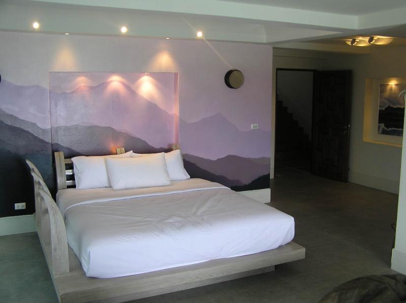 King size 2 way bed with mirror on the ceiling with balcony overlooking Tongson bay beautiful.