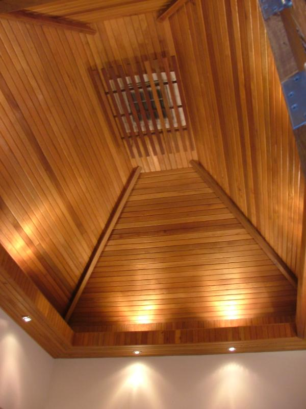 Vaulted ceiling insulate the master Bedroom and help with cooling in the tropical heat..