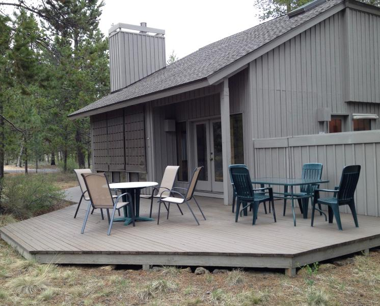 Deck with patio furniture, hot tub and gas grill