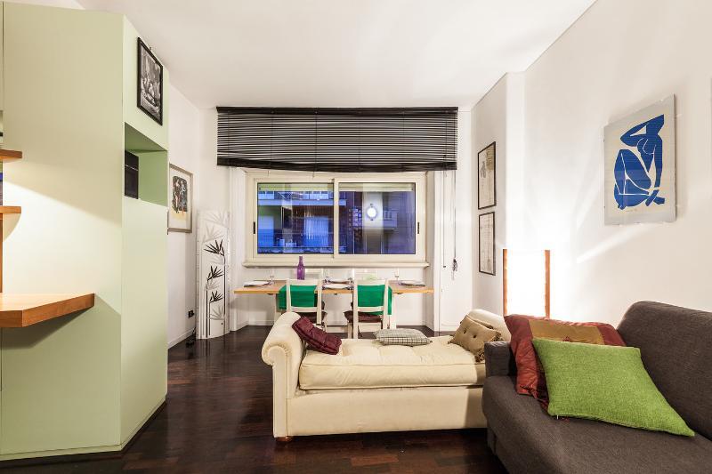 open space soggiorno e divano king size