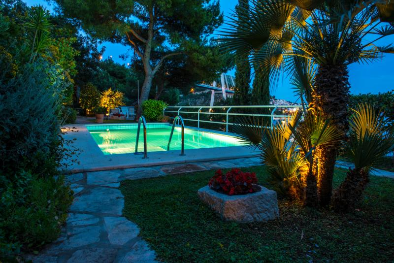 Our beautiful horizon edge pool with ambience light at sunset