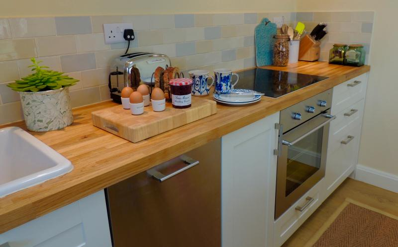 Brand new kitchen, full sized dishwasher, electric oven, fridge with freezer compartment.