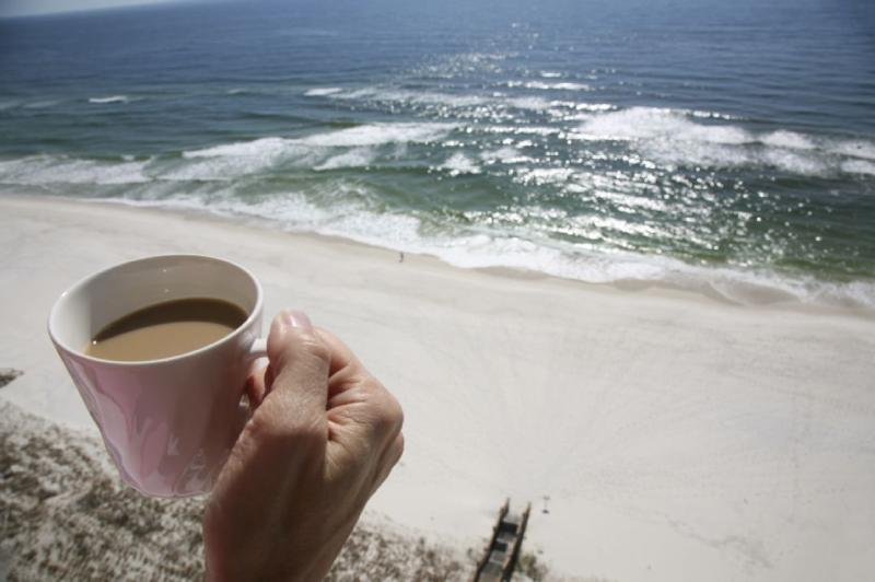 Wake up with a coffee and a walk on the beach