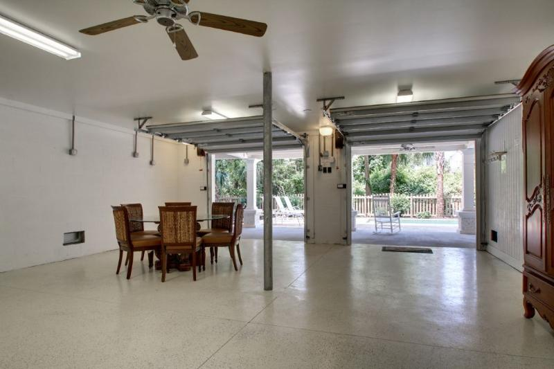Bonus Room in the Garage Leading Out To Pool Deck!