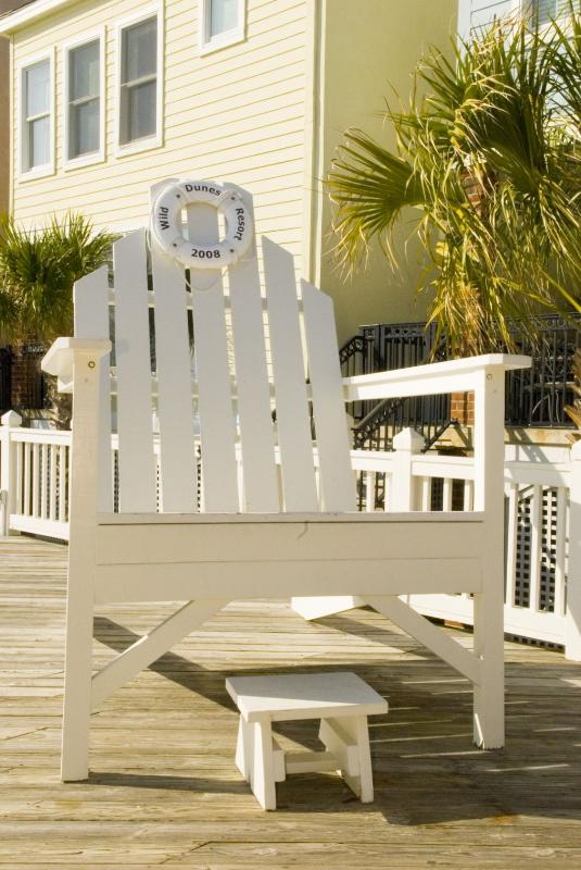 Take a photo on the huge beach chair in Wild Dunes