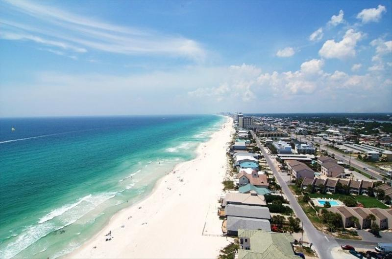 Unobstructed views westward of the beach from this 20th fl walk-around balcony