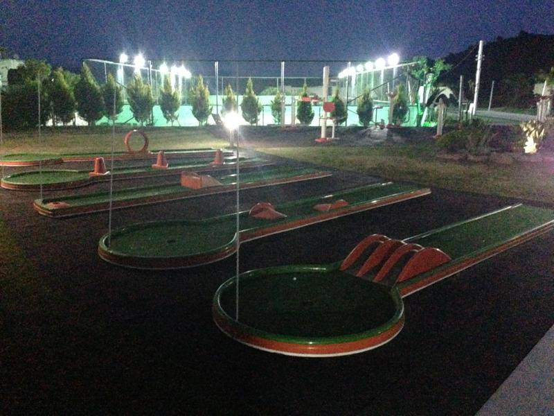 Mini golf and floodlit tennis at night