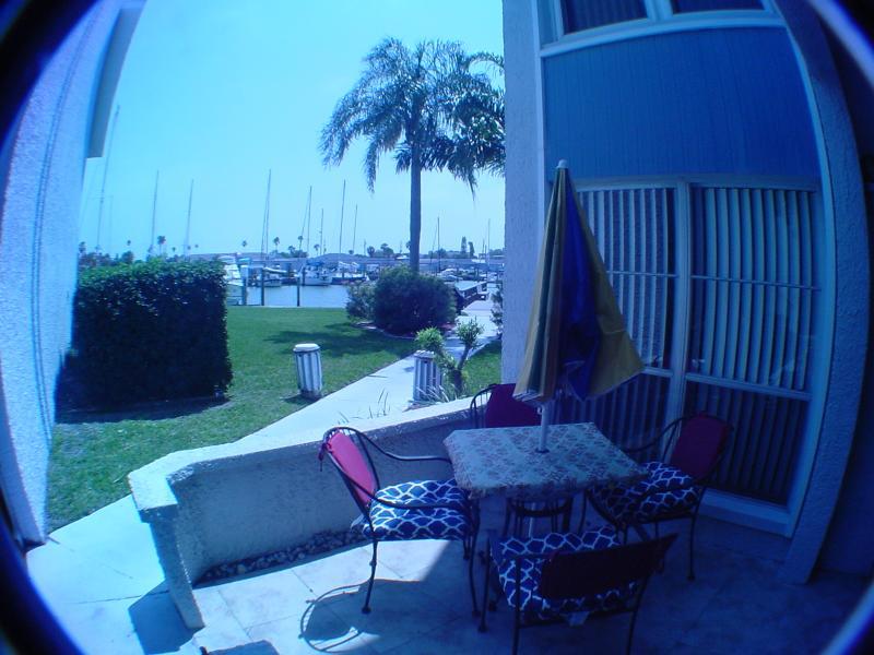 outdoor condo patio area for al-fresco dining with view of Boca Ciega Bay Marina
