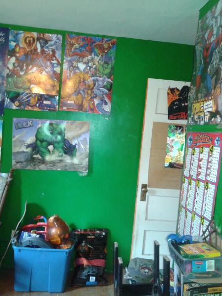 kids room, a couple of the marvel posters which totally cover walls, plenty of toys