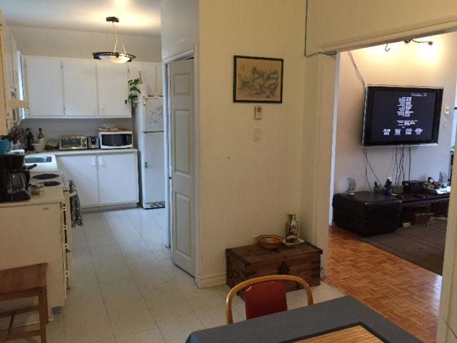 Full kitchen in distance.   Dining area (not fully shown) open to living room.