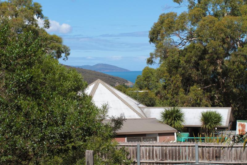 View from the kitchen looking towards the mouth of Carlton River. Beach is 10 minutes walk