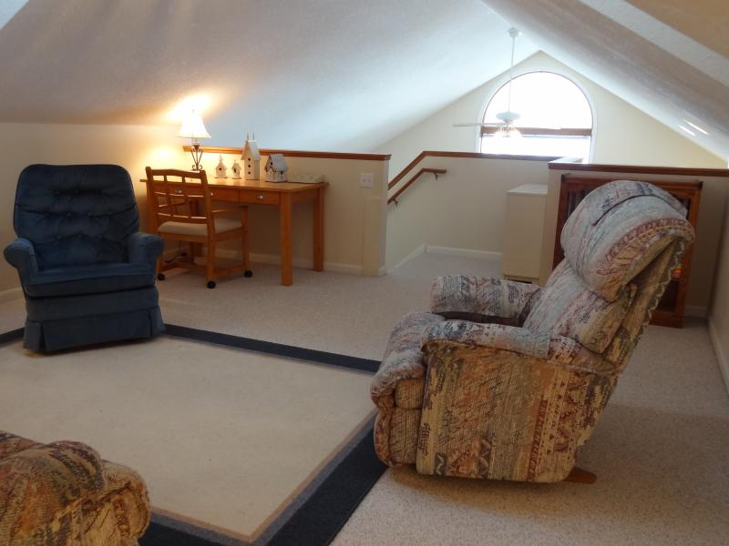 Loft above the main floor living room - includes a writing desk and two stocked book cases