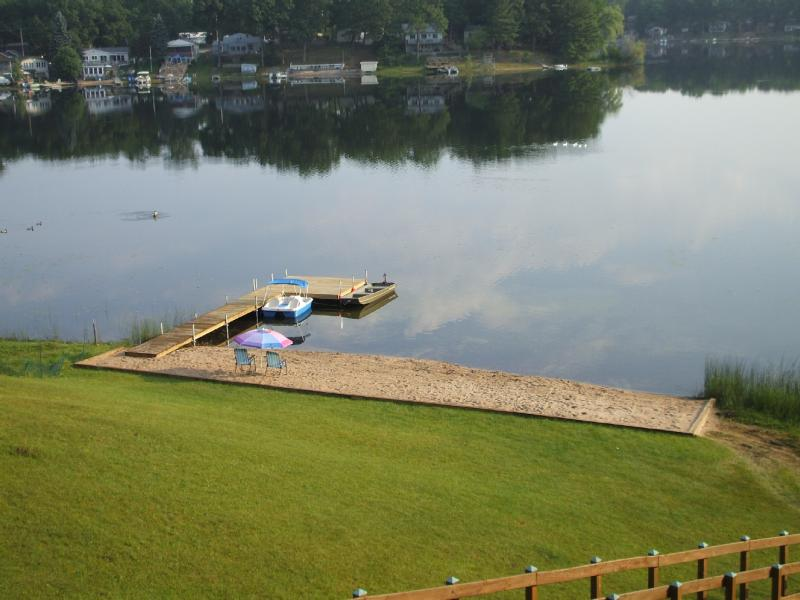 Private sandy beach area - 85 feet wide. Paddle boat and motor boat are included for your use.