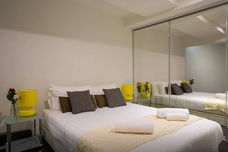Bedroom 1 with queen bed configuration.