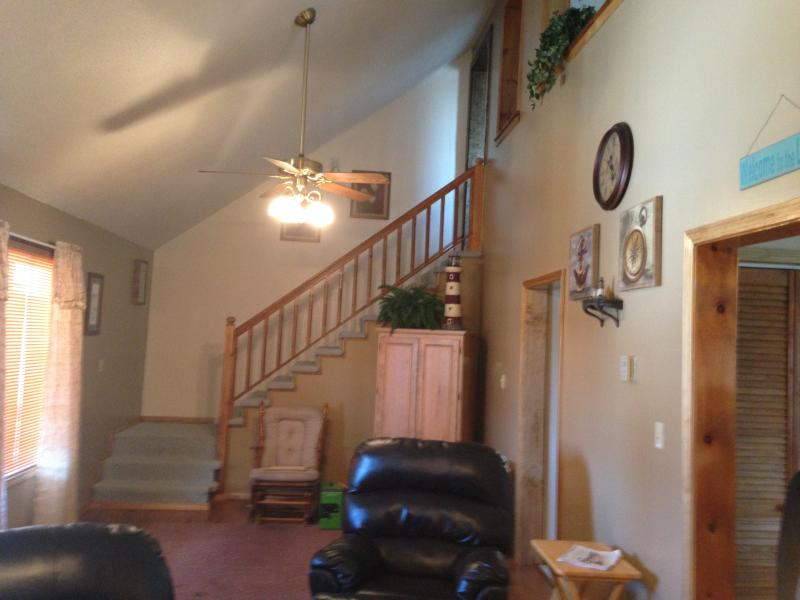 Lovely staircase and second level that overlooks the living room area.