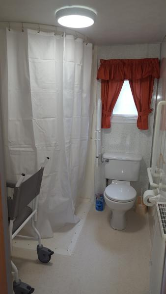 Wet Room with Shower Area suitable for Wheelchair users.