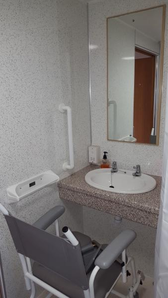 Sink Area with space underneath for wheelchair.