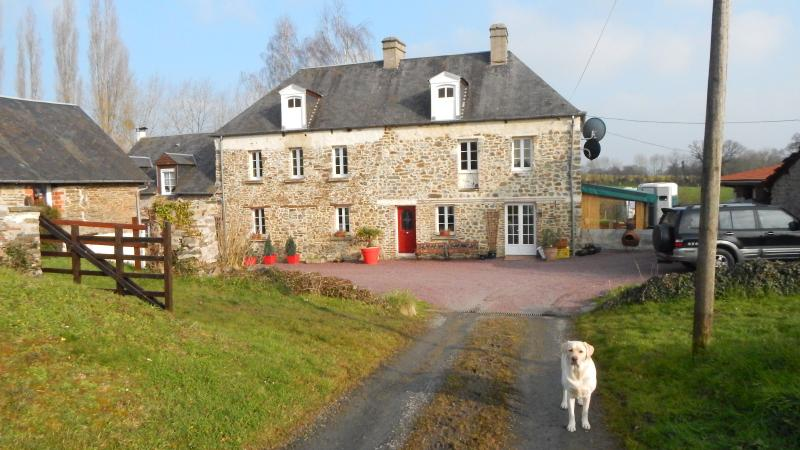 Main house with friendly Labrador to greet you.