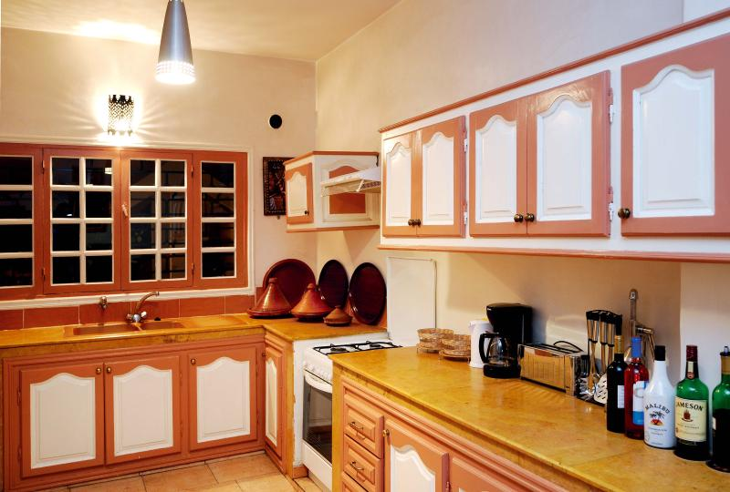 Fully equipped kitchen with large American fridge