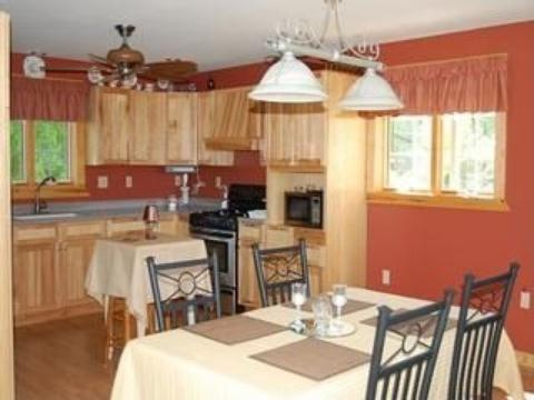 Picture can only capture 1/2 of the enormous  kitchen: custom cabinets, stainless steel appliances
