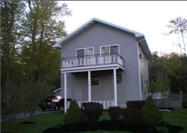 Newer home, surrounded by 3 acres of front, side, and back yards: privacy, play areas, relaxation