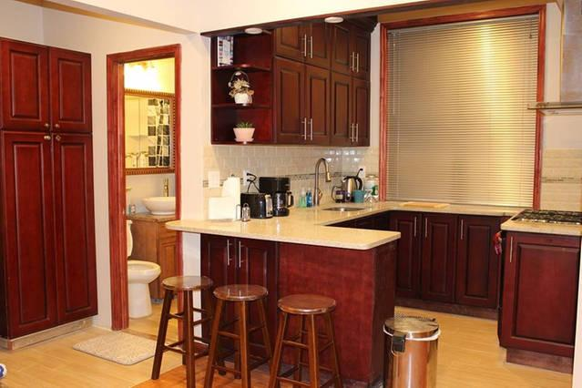 Open Floor Plan Kitchen with Stove, Fridge and equipped with essentials